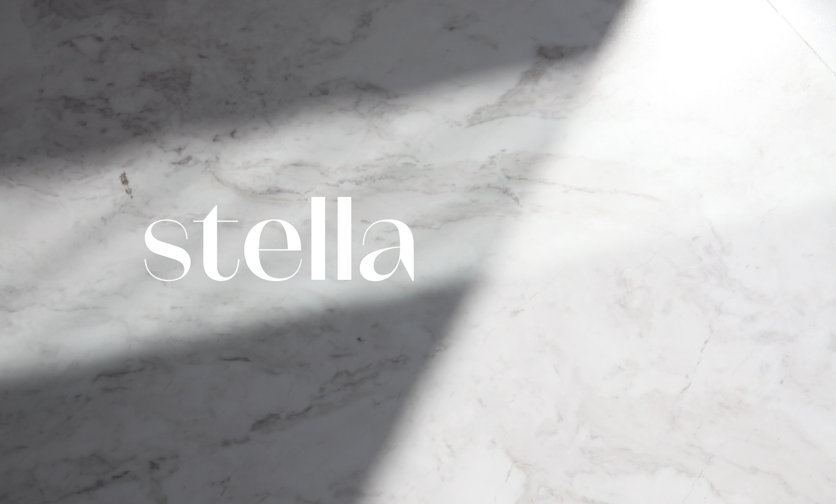 Stella white logo on marble