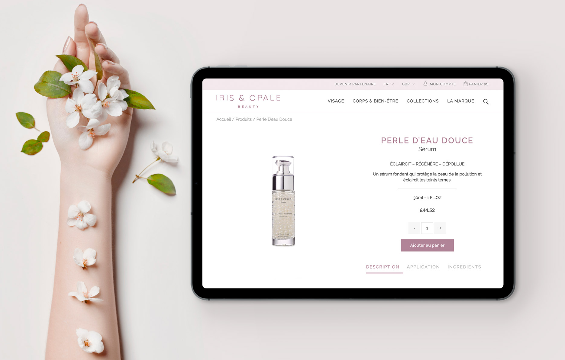 hand covered with flowers next to an iPad showing an ecommerce website